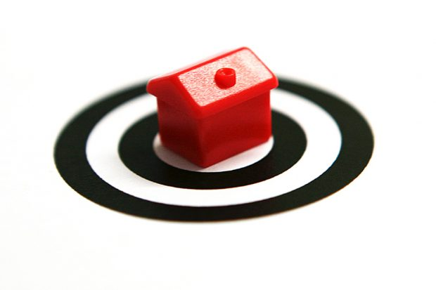 House on black target signifying the danger from property fraudsters.