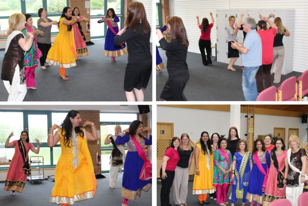 Colleagues learning Bollywood dancing.