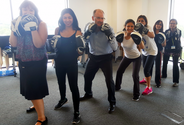 Colleagues take part in a boxing lesson.