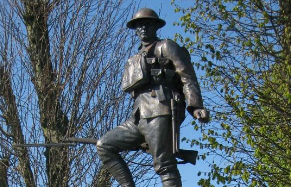 A sculpture of a British infantryman with rifle in hand.
