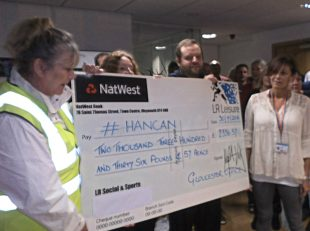 Handing over a cheque from the Gloucester Office