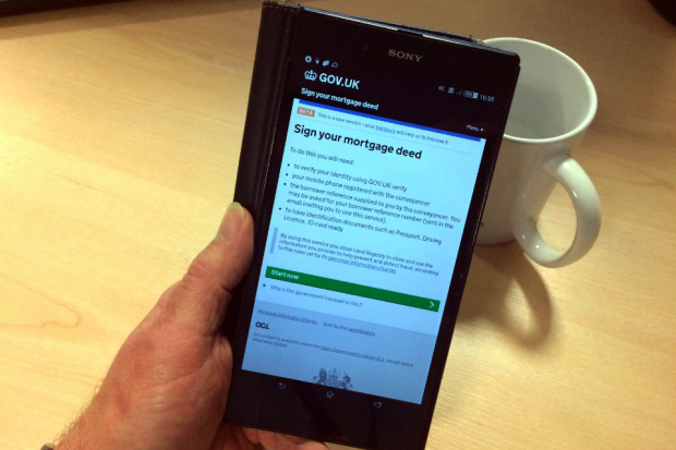 Smartphone showing 'Sign your mortgage deed' web page.