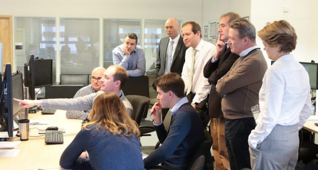 Visitors from GDS, including Kevin Cunnington, and senior HM Land Registry staff watch a casework demonstration.