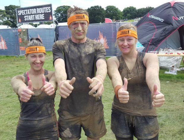 Thumbs up from three members of the Fylde Office team who took part in the Tough Mudder fundraising event.