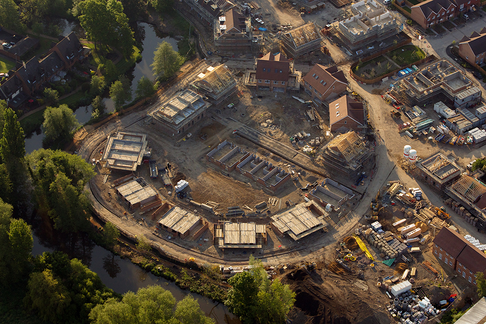 Aerial view of houses being built.