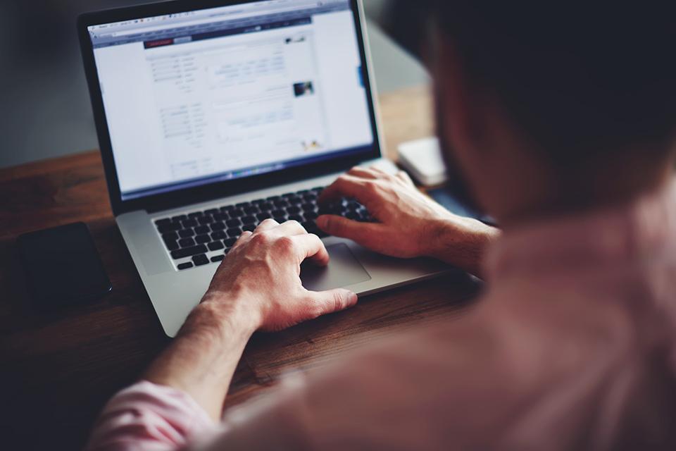 Man using a laptop on a desk