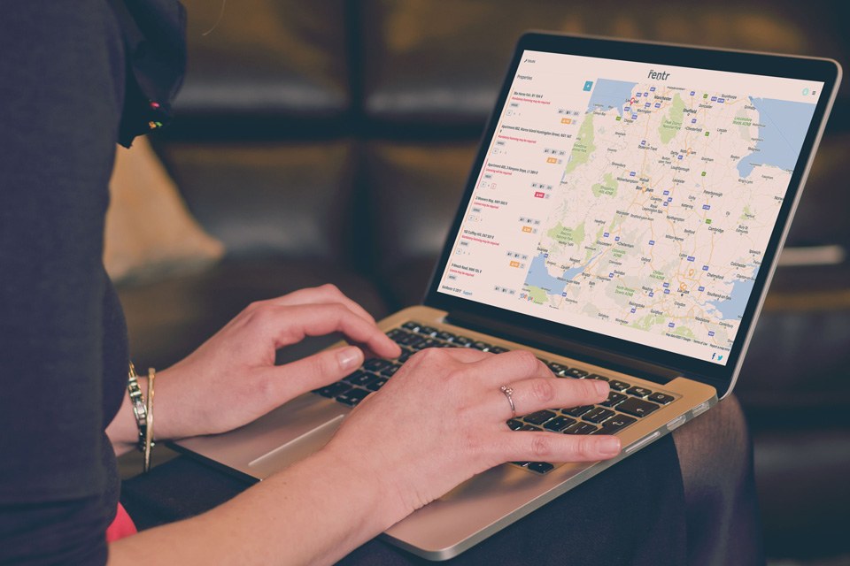 Woman using the GetRentr service on a laptop to search a map