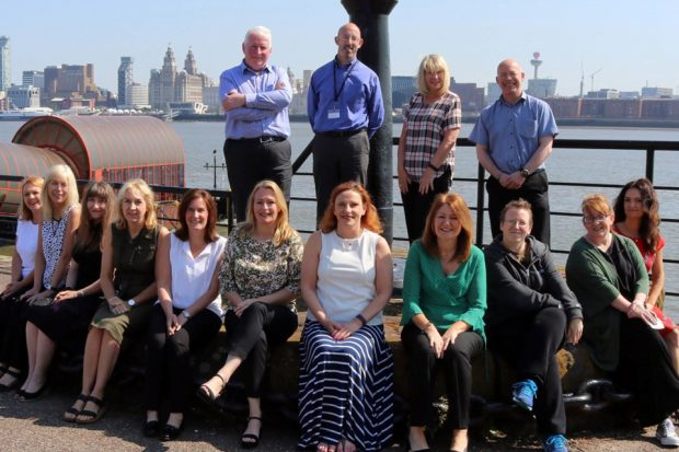 Our Data Services Team pictured by the Mersey river in Birkenhead