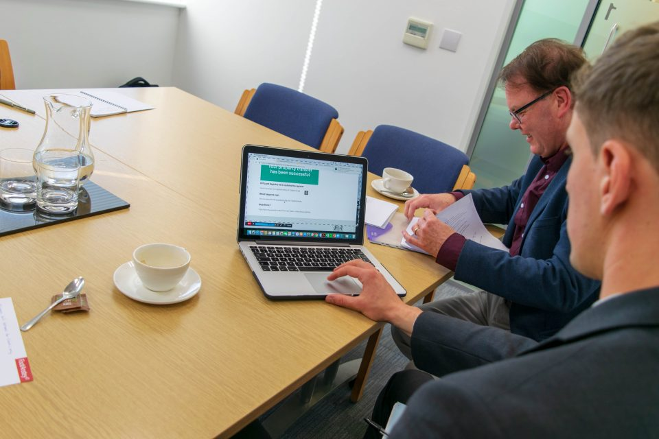Digital Street Team members using a laptop in a meeting room.