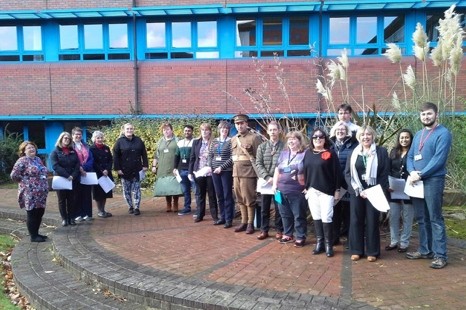 Telford choir standing in front of Telford office