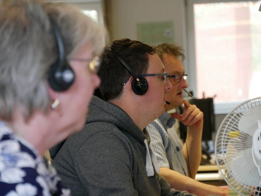side head view of three people from customer support team