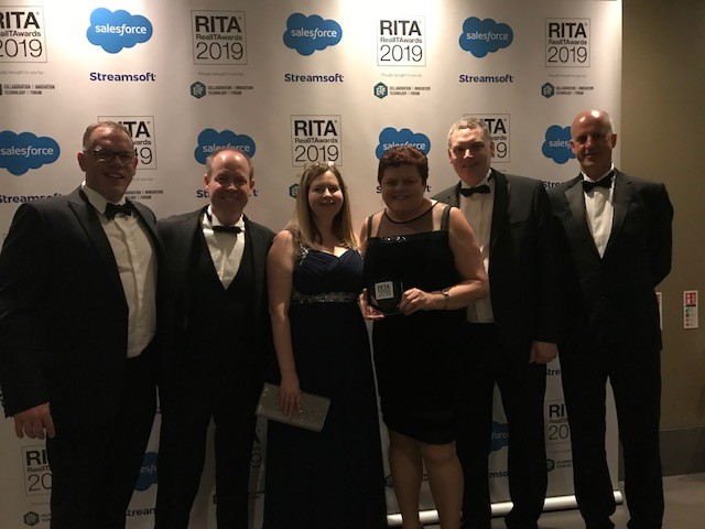 Team members from HM Land Registry and Kainos with their trophy at the Real IT Awards