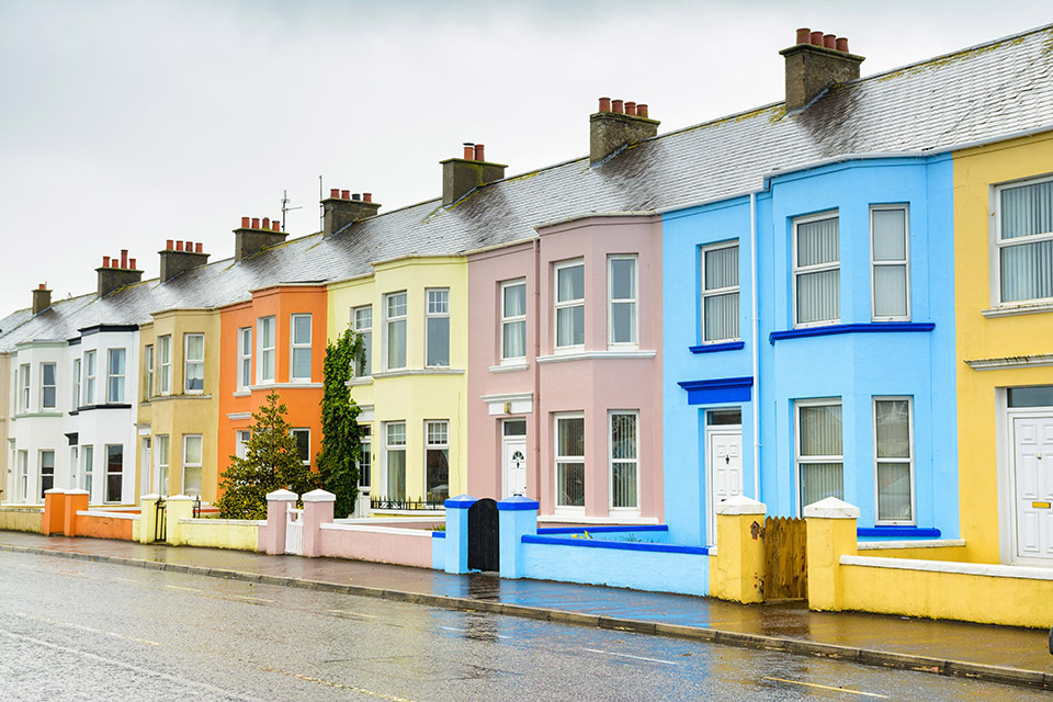Row of terraced houses with each painted a different colour.