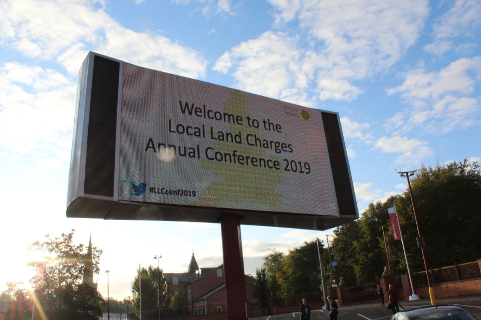 Sign saying 'Welcome to the Local Land Charges Annual Conference 2019'.