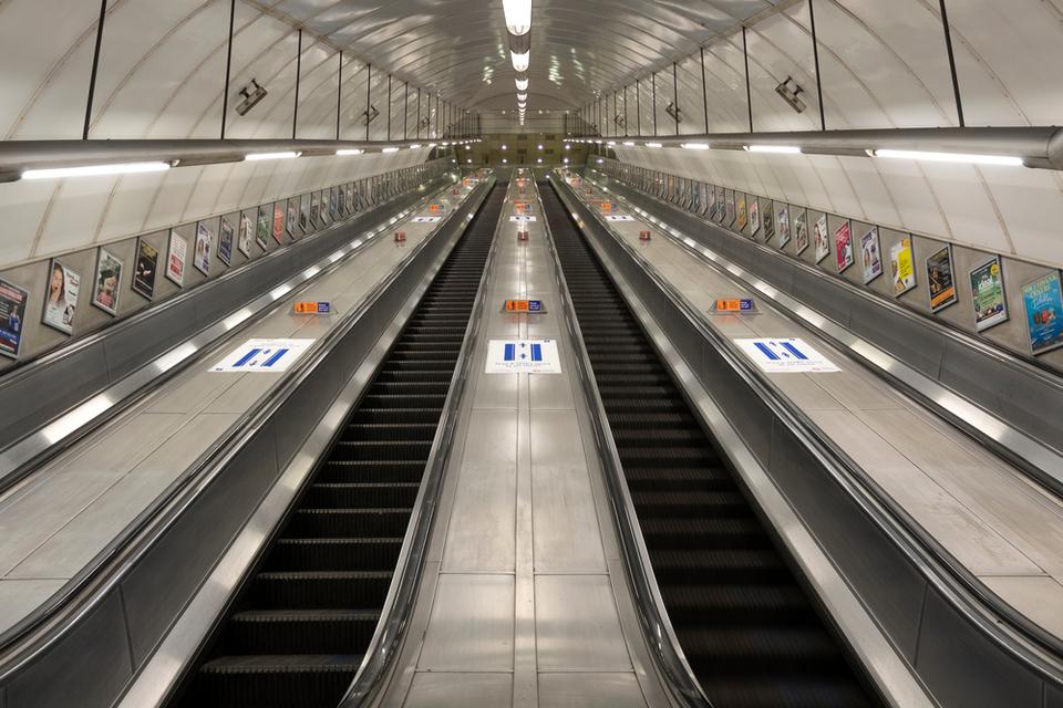 Empty escalator ascending steeply to the horizon.